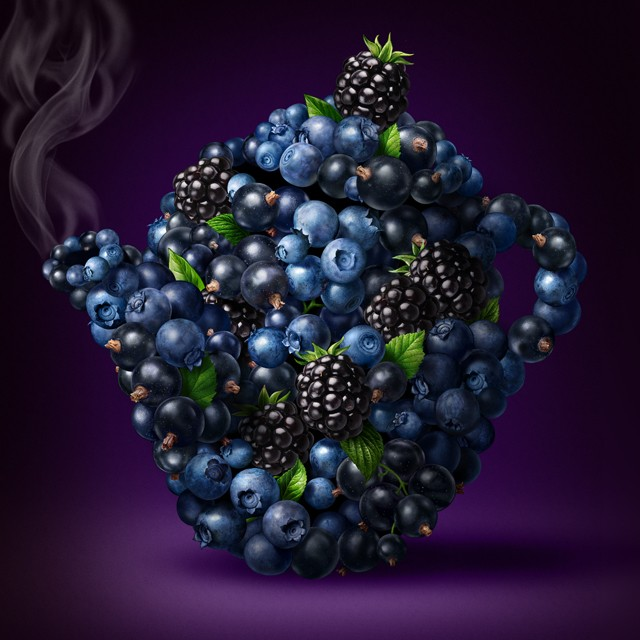 Teapot of berries. Blueberries, currants, blackberries.